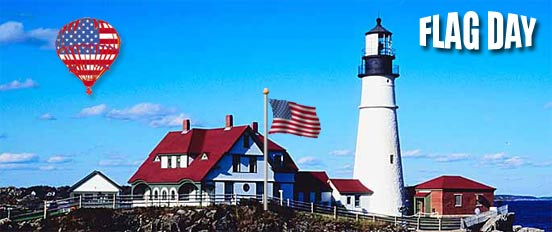 American Flags flying over lighthouse